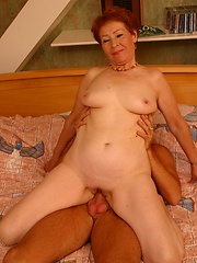 Redheaded granny enjoys riding hard young cock