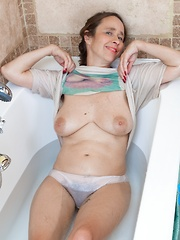 Josie strips nude before taking a sexy bath