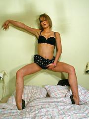 Horny MILF getting herself wet by masturbating